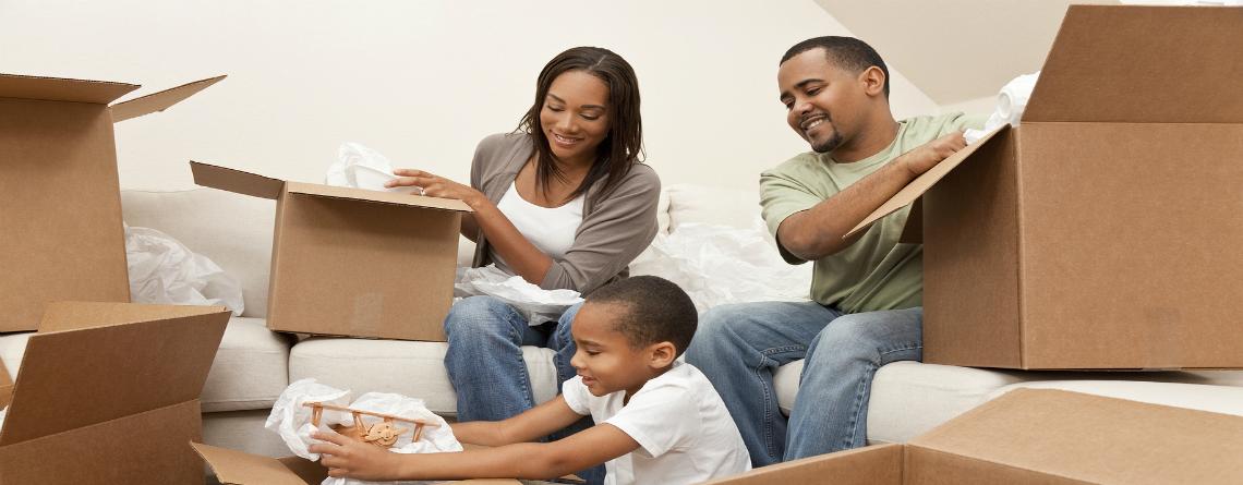 bigstock-African-American-Family-Unpack-15141902