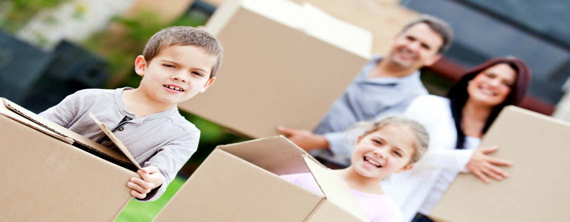bigstock-Family-moving-home-and-carryin-31699619